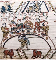 Bayeux Tapestry - Scene 43: Bishop Odo blesses the first banquet that Duke William and the Norman Barons hold on English soil. The bishop is recognisable by his tonsure and also by the fish in front of him. File:Bayeux Tapestry scene43 banquet Odo.jpg (via Wikimedia Commons)