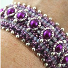 Plum Hand Bead Woven Bracelet by ChainedByLightness on Etsy, $94.00. Design by Sabine Lippert