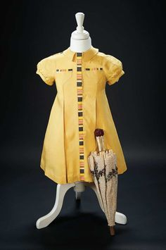 "Yellow Linen Dress Worn by Shirley Temple in the 1936 Film ""Stowaway"" $2000+"
