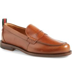 Free shipping and returns on Gucci 'Tobias' Penny Loafer (Men) at Nordstrom.com. Richly polished leather shapes a sleek Italian-madepenny loafer with meticulous stitching, while Gucci's signature grosgrain ribbon at the counter finishes the look with branding appeal. Penny Loafers, Loafers Men, Tobias, Shoe Box, Grosgrain Ribbon, Counter, Stitching, Oxford Shoes, Dress Shoes