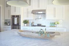 white kitchen dough bowl carrara marble shaker white cabinets