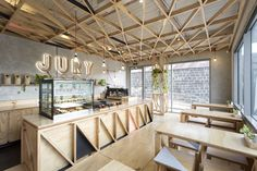 Gallery of Small Cafe Designs: 20 Aspirational Examples in Plan & Section - 17
