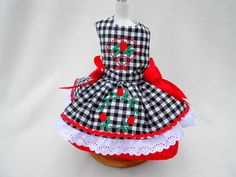 This adorable black and white gingham dress has embroidery flowers, lace and red satin bows. Dress has a red underskirt and completely lined. 30.00
