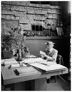 """right at 89 (1956)  At Eisenstaedt's suggestion, Wright sits down at his desk to read his mail. """"As he reads his mail, Wright loosed consciousness of the camera"""". Photographed at Taliesin possibly in May."""