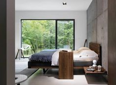 Team 7's Riletto bed with the Sidekick and TreeO tables brings Scandinavia's clean and simple architectural lines into the bedroom