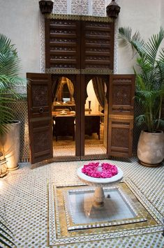 Moroccan fountain courtyard with rose petal fountain - Royal Mansour is located in Marrakech, Morocco and is a 5 star luxury hotel and spa with private riads and fine dining. Designs featured at www.martynwhitedesigns.com