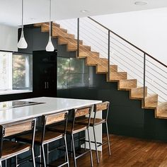 Modern wood stairs with stainless cable railing.