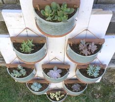 s 13 planter ideas that blow all other planters out of the water, container gardening, gardening, repurposing upcycling, Turn old light fixtures into plant towers
