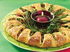 Easily transform crescent rolls into a festive first course for 16. Wrap red and green veggies inside and decorate with fresh rosemary greenery. Its a beautiful edible centerpiece!