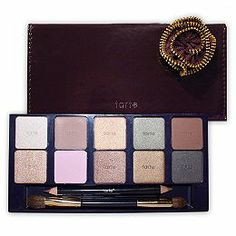 Tarte Femme Naturale Natural Eye Palette 2013 A reusable purple case filled with 10 mineral-based eye shadows, a double-ended brush with greatness eye shadow brush, a double-ended eyeliner, and a direction card that illustrates some of their favorite looks! Featured in this eye shadow palette are:: Shimmering Buff, Soft Sand, Golden Peach, Shimmering Sage, Soft Sienna, Golden Tan, Soft Petal Pink, Golden Plum, Shimmering Cocoa, Golden Navy Double-ended eyeliner: Golden bronze, shimmering…