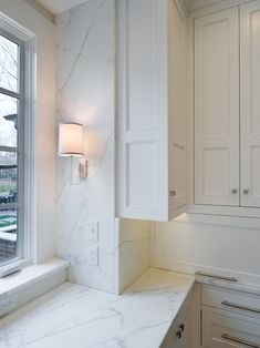 Cabinetry, marble, sconce integration, streamlined hardware | Andrew Roby General Contractors
