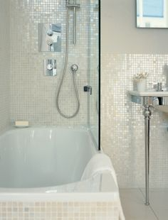 White Pearl tile on bathroom walls and in shower. https://www.subwaytileoutlet.com/products/White-1x1-Pearl-Shell-Tile.html#.VOUG7_nF-1U as accent tile