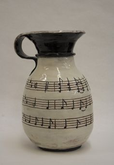 Terra cotta jug with sheet music. Coil constructed by Jessica Hanley.