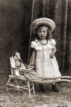 Little Girl with Doll by ookami_dou, via Flickr