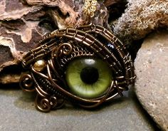 brooch by twisted sister arts... Does it look like an Octopus eye? Don't dress like Octo! Be the Octo ! I wonder if it's big enough to add to a strap and use as an eyepatch ....
