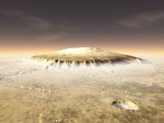 August 20, 2012-Olympus Mons -the tallest known volcano and mountain in our solar system. The central edifice of this shield volcano stands 27 kilometers ( 88,580 ft) high above the surface -or three times the elevation of Mount Everest above sea level and 2.6 times the height of Mauna Kea above its base. Image credit: NASA
