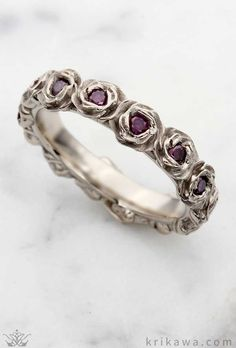 Ring O' Roses Wedding Band in white gold with brilliant purple diamonds! Design your floral wedding band in the metal and stones you love most!