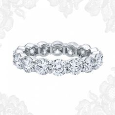 I would prefer to wear this over an engagement ring any day! Round Brilliant Bar-Set Diamond Wedding Band | Harry Winston