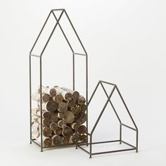 """Sturdy and functional, this ironwork frame adds a dash of rustic charm to refueling the fireplace.- Iron, powder coat finish- Indoor use only; will rust if left outdoors- ImportedSmall: 24""""H, 17.75""""W, 12.25""""DLarge: 49.25""""H, 18""""W, 12""""D"""