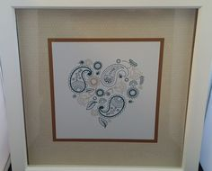 """Using Stampin' Up Paisleys and Posies I created a picture just like the one showcased in the Seasonal catalogue. I used Dapper Denim and Tip Top Taupe stamped on a 7 1/2"""" x 7 1/2"""" square and then layered to put in a box frame."""