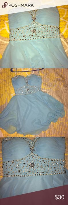 Strapless homecoming dress Length comes down to about knee length. Decently comfortable for a strapless dress and enough support without a strapless bra with it. Dresses Strapless
