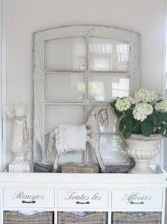 Adding a lovely old window to decorating inside.