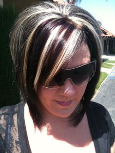 A Line bob haircut. Black with blonde and violet