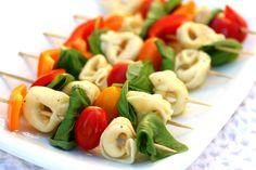 Pasta Salad Skewers:  1 package cheese tortellini  1 red bell pepper  1 orange bell pepper  1 pint of grape tomatoes  fresh basil leaves  Italian dressing