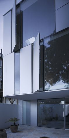 Satin-anodized aluminium cladding, fixed and opening from Juliet glass balcony.