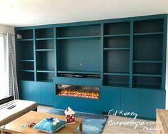Bespoke TV unit with electric fire Bookshelves, Bookcase, Carpentry Services, Electric Fires, Bespoke Furniture, Tv Unit, Shelving, Contemporary, Conservatory