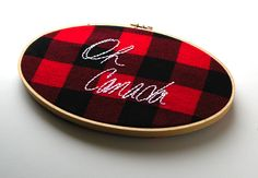 plaid + hoop + embroidery = love.  I wish more embroidery were done on plaids....  Oh Canada - 5x9 wooden hoop embroidered wall hanging. $25.00, via Etsy.
