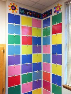 CLASSROOM ART DISPLAY laminated pieces of paper with pegs hot glue gunned to the top - for displaying work