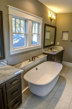 cherrytown bungalows by revolve residential dual vanities and a tub with the faucet