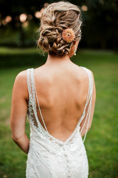 Perfect for a garden wedding, this real bride, Stefanie is gushing with love in this sheath wedding dress. The V-neck is lined with Swarovski crystals and silver embroidery while layers of beads drapes down the low open back. #Moonlightbridal #realbride #realwedding #weddingdress #weddingdressideas
