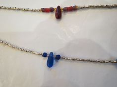 Glass and Ethiopian silver beaded necklaces.