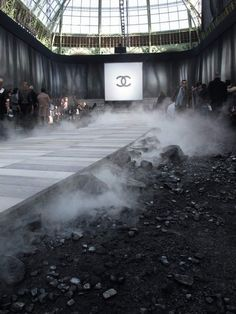 Talk about texture.  Smoke, rocks, gravel, slate, and luscious fabrics.  Chanel Fall/Winter 2011. #Event #Design #Catwalk