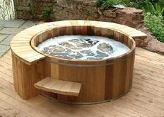 round wooden accent hot tub. Anything is possible at Blockco.co. Real People with Local Solutions.