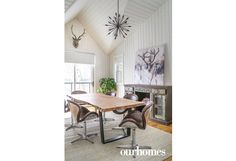 Leather armchairs swivel around the live-edge conference table in the home office.  http://www.ourhomes.ca/articles/build/article/whitewashed-weekender-ripe-with-rustic-chandeliers