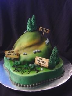 """An """"almost"""" over the hill cake, for a 30 year old...  an outdoors enthusiast!  12"""" round (sculpted) and a doll pan for the &q..."""