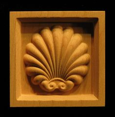 Carved wood Corner Block featuring an elegant shell form that works with a variety of styles.  Perfect for Door...