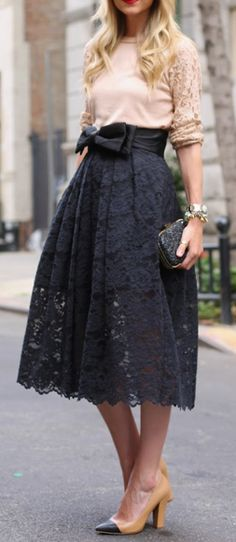 Lace Skirt Outfit Idea #1. A midi length black lace skirt is adorable with a blush sweater with lace sleeves, and cap-toe pumps.