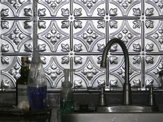 Textured Metal Backsplash - possible to re-create on the cheap with textured paintable wall paper and spray paint?