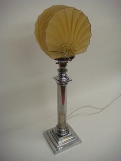 Image from http://www.salvo.co.uk/images/userimgs/41040/Art-Deco-Table-Lamp-circa1930_58241_1.jpg.