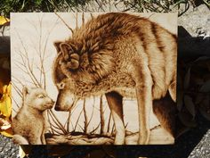 """""""Snow Day with Mom"""" Wolf and cub animal pyrography by Cara Jordan, 16 by 20 inches"""