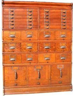 Card Catalog!! With varying sized drawers! Ty will have to construct this for me, because they're much too expensive, and i'm not talented enough to make it myslef.