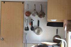 Peg board for camper storage