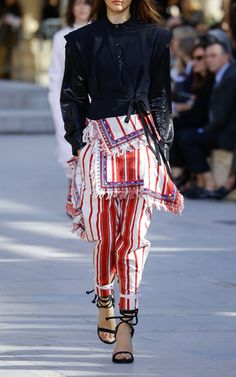 This harem style **Isabel Marant** trouser features a high rise with wide crossover waistband, sef-tie details at the ankle, and an all over striped design.