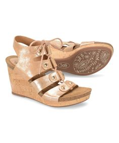 b46fab53288 A chic wedge in a lace up ghillie style in a metallic leather that has  metallic stud accents and features leather lining and a suede lined footbed  with soft ...