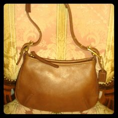 Authentic Vintage Coach Handbag. A Classic The perfect small handbag.  Brown leather Coach purse in very good condition. A classic for your collection. Coach Bags