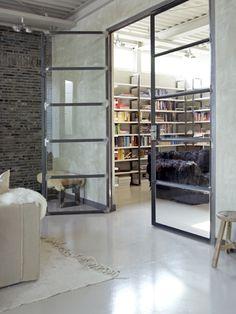 Brick wall, concrete floor and big steel and glass doors? Sure!